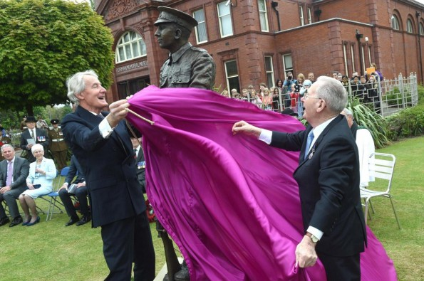 Deputy Lieutenant for North Yorkshire the Hon. David Dugdale (L) and Tom Dresser's son Tom unveil the statue