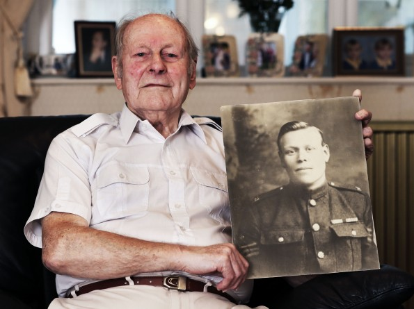 WORLD WAR ONE: Arthur Harris with a picture of his father, Quartermaster Sgt Alfred Harris. Picture: STUART BOULTON.