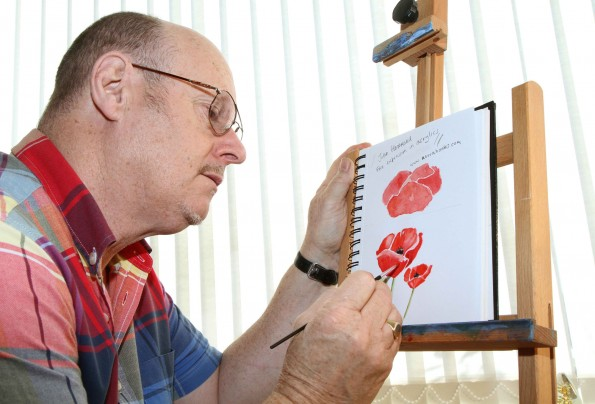 FINE DETAIL: Artist Malcolm MacDonald at work on the poppy painting for the front cover of a book of children's war poems. Picture:RICHARD DOUGHTY (11860787)