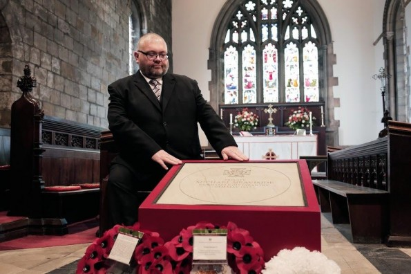 Great-grandson Ian Heaviside with the Michael Heaviside VC memorial stone after the service at St Giles Church in Durham. Picture by Stuart Boulton.