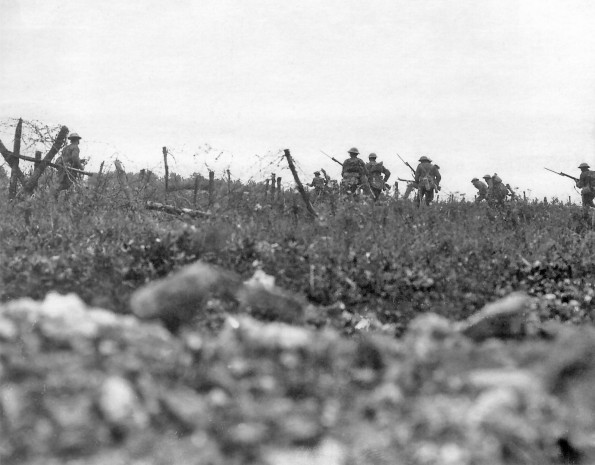 WALK OF THE BRAVE: Soldiers from the Wiltshire Regiment advance through the barbed wire during the Battle of the Somme