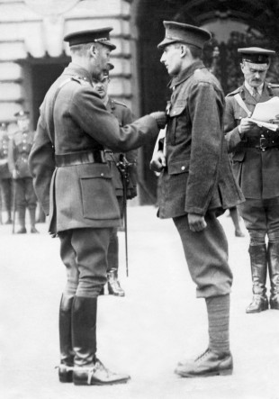 Private Tom Dresser being given his VC medal by King George V at Buckingham Palace, July 21, 1917