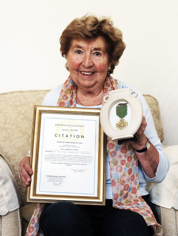 War Hero: Joan Ludlow of Redcar with her grandfather's croix de guerre and citation. Picture: Stuart Boulton.