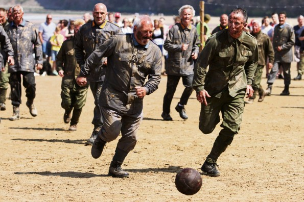German and British soldiers re-enact the football match, played during a truce during the First World War, on Saltburn beach