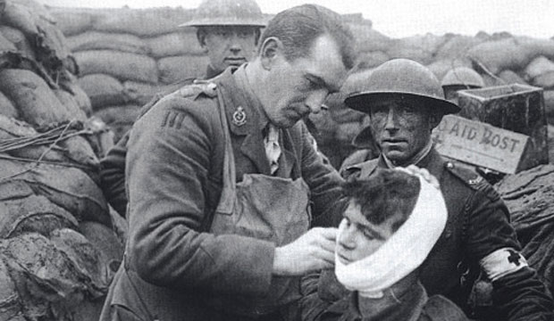 A soldier gets treatment for his wounds