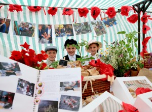 STALLS: Children from local schools set up WW1 food stalls in Durham Market Place as part of Durham Farmers' Market Pictured Jackson Stevenson, Regan Bowman, and Robyn Pipe, from Easington Colliery Primary School. Picture: SARAH CALDECOTT