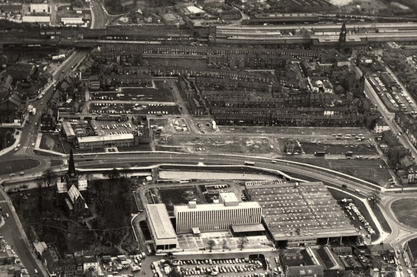 AERIAL VIEW: Darlington in the early 1970s. St Cuthbert's Church is in the bottom right corner, with Parkgate leading up from it, past the Civic Theatre to Bank Top Station. On the right of the picture, Victoria Road can be seen leading up to the station clocktower. Beside the new ring road, the outline of the demolished horizontal terraces of Backhouse Street and Park Street can be seen. The first standing houses are those of Park Place, which runs from Victoria Road to the Civic