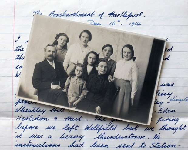 EYEWITNESS: Mary Stainthorpe is far right on this 1920s family picture; beneath is her handwritten account of the bombardment