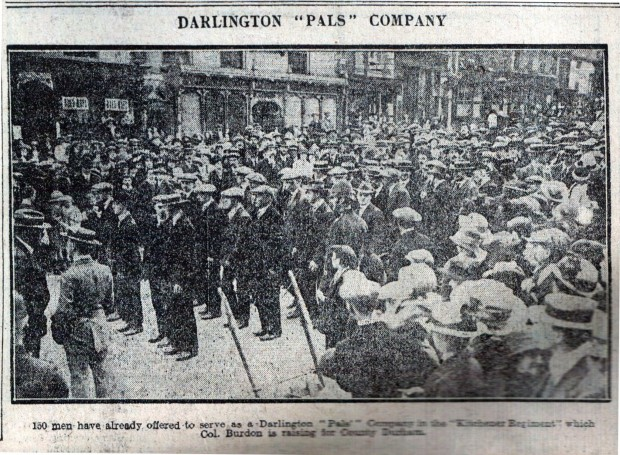 FIGHTING FIT: The first men signed up for the Darlington Pals at the old Town Hall on September 5, 1914. This picture was on the front page of the first Evening Despatch newspaper, which was started to complement The Northern Echo's morning news of the war. The Pals are lined up with Horsemarket in the background - the distinctive arched windows are now a cafe. Alix Liddle may well be among them somewhere