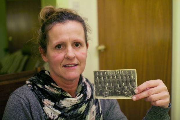 FAMILY PRIDE: Amanda Nelson with a photograph of her grandfather Wildfred Smith, with fellow soldiers before he was sent home from the war