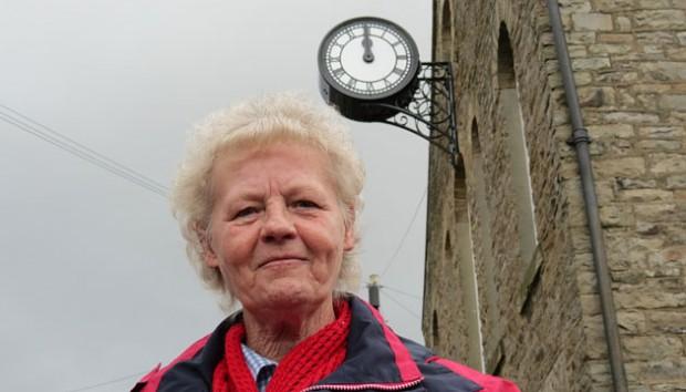 WAR MEMORIAL: Carol Antal, trustee of Westgate Village Hall, stands beneath the restored memorial clock