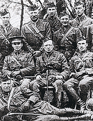HONOURED GUEST: Lt-Col Winston Churchill, centre, with the Royal Scots Fusiliers in early 1916 at Ploegsteert in Belgium – he was a mile or so north of Gunner George