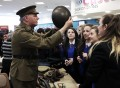 TIME LORD: Tony Hall, of the Time Bandits re-enactment group, and pupils from Thornaby Academy during a First World War event at the town's central library