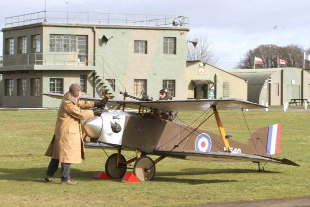The rare Eastchurch Kitten World War I fighter plane is started up by volunteers Grant Sparks and Brian Watmough at the Yorkshire Air Museum
