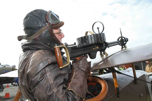 Volunteer Brian Watmough taking aim on the rare Eastchurch Kitten World War I fighter plane at the Yorkshire Air Museum