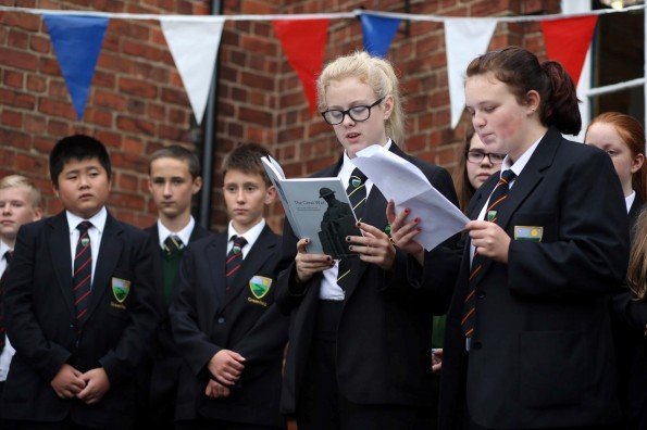 INSPIRATIONAL READINGS: Greenfield Community College pupils read poetry they have written, inspired by the First World War and appearing in a book created by the Aycliffe Village Local History Society. Shannon-Leigh Banks (13) and Rachel Bremner (13) read their untitled poem.  Picture: CHRIS BOOTH