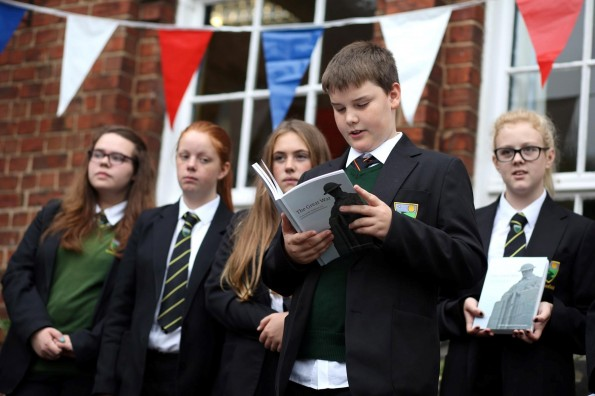 INSPIRATIONAL READINGS: Greenfield Community College pupils read poetry they have written, inspired by the First World War and appearing in a book created by the Aycliffe Village Local History Society.Ryan Aitken (13) reads his poem 'The day I went away'.  Picture: CHRIS BOOTH