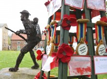 The knitted medals near the wicker sculpture of the WWI soldier at Great Ayton. Picture: RICHARD DOUGHTY PHOTOGRAPHY
