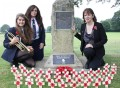 HEROES REMEMBERED: (L-R) Ripon Grammar School pupils Martha Barber and Shannon Millar with Old Riponian Claire Green at the First World War commemorative stone with poppies bearing the names of all those former pupils and masters who were lost.