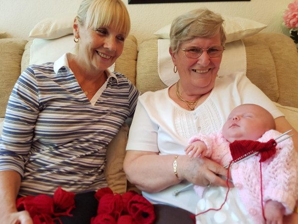 FAMILY: Sky Kathryn McGinty, just five weeks old, helps grandmother Mary Harper and great aunt Judy Allen knit poppies for the appeal