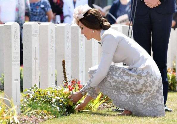 CENTENARY REMEMBERED: The Duchess of Cambridge lays flowers at the grave of the unknown soldier at Tyne Cot cemetery at Ypres