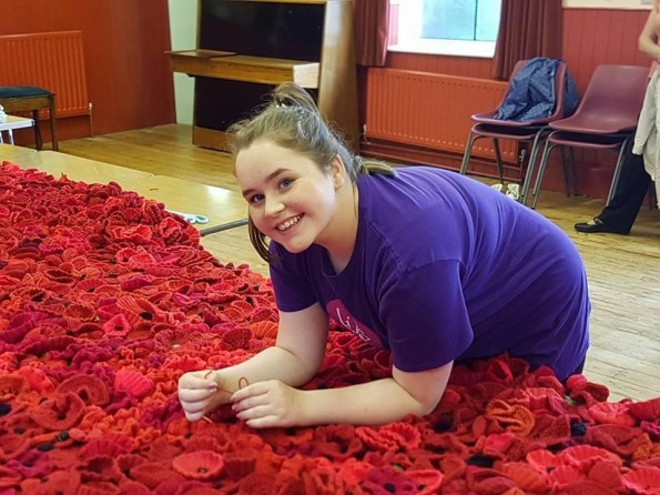 VOLUNTEER: Youngest project member Neive Archer, 14, of Newton Aycliffe, attaches the last poppy to the display