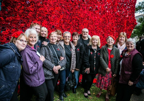 POPPY: Team Poppy members spent three full weekends attaching 19,240 poppies to two large nets Picture: SARAH CALDECOTT