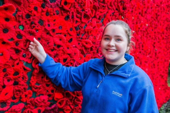 TRIBUTE: 13-year-old Nieve Archer, from Newton Aycliffe, sewed on the last poppy onto the display Picture: SARAH CALDECOTT