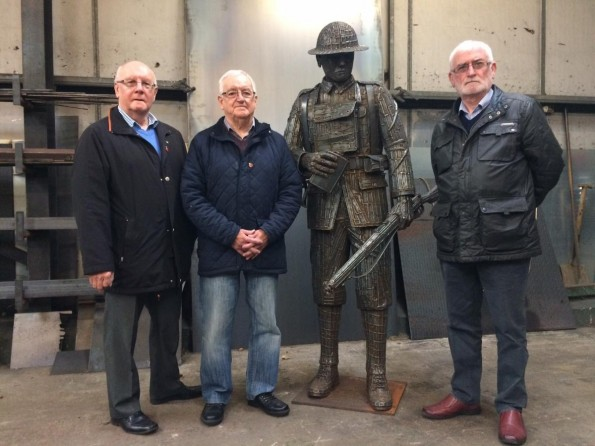 IMPRESSED: Ray Sunman, Alan Hodgson and Norman Hyland check out the statue for Tursdale WWI war memorial