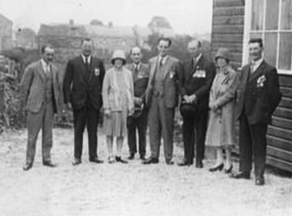 DEMOBBED: George Thorn, on the extreme right wearing his medals, with other villagers outside the British Legion hut in Cotherstone in the 1920s before it burned down. The woman next to him may be his wife Isabel, but her identity is not certain