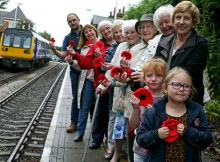 A team of knitters have begun making thousands of poppies to be ready for Armistice Day. They are pictured at Nunthorpe Railway Station in Middlesbrough, fronted by Sophie Marshall (6) and Iris McGlynn (5). Picture: CHRIS BOOTH