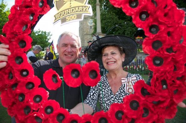 WAR TRIBUTE: Lord Lieutenant Sue Snowdon with Brian Laverick, of the Boundary 500 Motorcycle club, with one of the wreaths. Picture by Keith Taylor