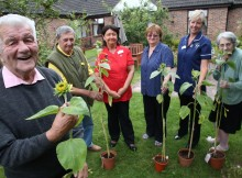 ALL SMILES: Residents Bill Todd and Gordon Balfour, co-ordinator Angela Penman, manager Alison Kelly, deputy Dawn Watts and resident Jessie