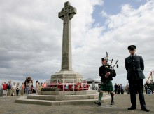 Piper David McKenna plays a lament at the war memorial during the First World War commemoration event in Seaham. Picture: DAVID WOOD