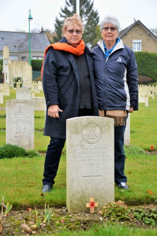 GRAVE: Margaret Kermode (right) and her cousin Jenny McDonald at the grave of L Cpl John McDonald