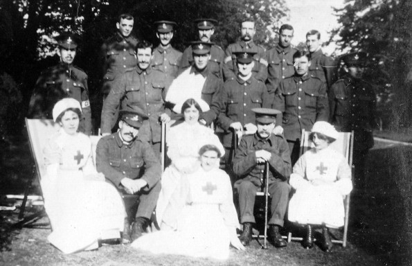 GRAVE SETTING: nurses and patients behind the Friends Meeting House – you can see gravestones in the background
