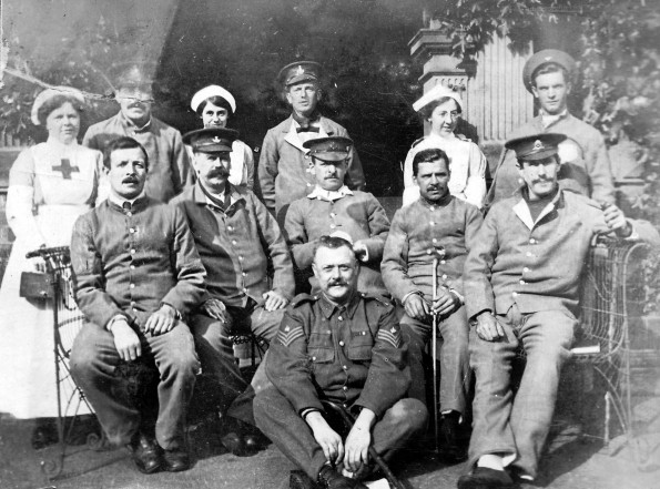 HEALING HEROES: A VAD nurse with soldier patients in the grounds of the Woodside mansion in Darlington – the pillars in the background appear to be on a loove, or folly, in the Woodside ground
