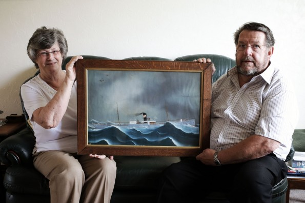 IN THE FRAME: Bob and Pauline Scarre with their painting of the SS Thirlby