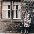 LEFT BEHIND: Eliza and Michael Lowery junior, the son his father never saw, outside their home in Clarence Street shortly after the end of the war